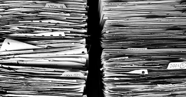 Image of files and documents to be sorted through with the help of an Indiana securities law attorney in response to a request for documents from the Securities Division.