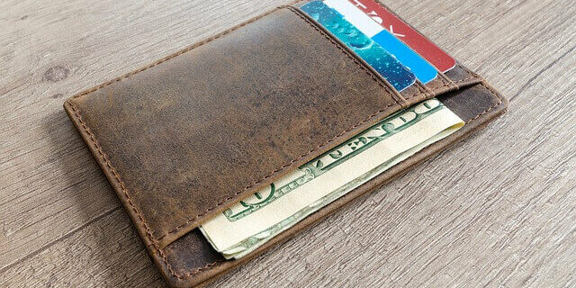 An image of a wallet with cash and cards, representing how the Indiana disability lawyers of Camden & Meridew can help injured workers minimize the financial implications of the workers' compensation and Social Security offset.