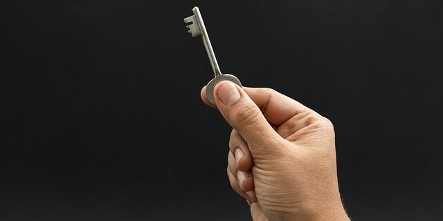 Image of a hand holding a key, representing how Camden & Meridew, P.C., attorneys can assist you with issues related to cohabitation laws in Indiana.