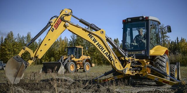 An image of a backhoe, representing excavator responsibilities when digging and the need to know Indiana call before you dig laws.