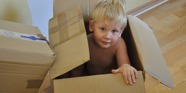 An image of a child in a moving box, representing the need to know the law in Indiana relocation custody cases and how Julie Camden can help with relocation matters.