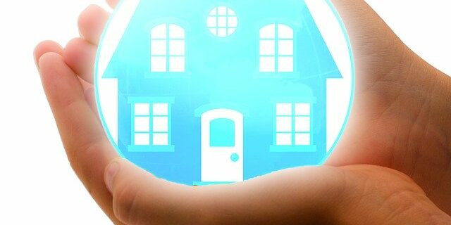 An image of hands holding a house in a bubble, representing how the foreclosure defense attorneys at Camden & Meridew, P.C. can help homeowners understand how to stop foreclosure in Indiana in a way that preserves dignity and assets.