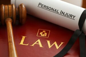 """Image of gavel next to scroll reading """"personal injury,"""" representing how an Indiana personal injury attorney from Camden & Meridew, P.C. can help get back some of what you've lost after an accident."""