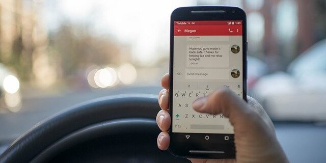 Image of a person texting and driving, representing the importance of knowing about the Indiana distracted driving law and seeking the advice of an attorney if you are injured by a distracted driver.