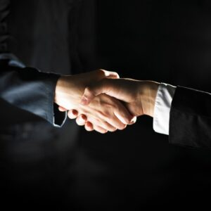 Image of two hands shaking, representing how working with an Indiana business lawyer from Camden & Meridew, P.C. can benefit your business.