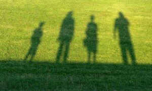 Image with the shadows of a family standing apart, representing how Fishers divorce attorneys, Camden & Meridew, can help you through the pain of a divorce.