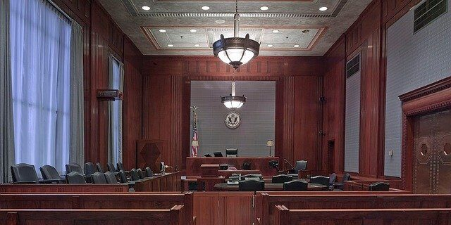 Image of an empty courtroom, representing Indiana litigation changes that have resulted from the coronavirus pandemic and how a Hamilton County attorney from Camden & Meridew can help clients navigate related challenges.