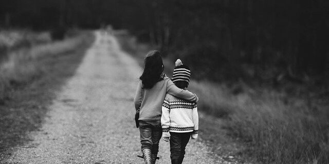 Image of two children walking on a road, representing how Camden & Meridew can help you understand the relationship between Indiana child support and Social Security benefits.