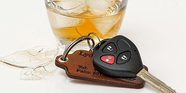 An image of car keys and a drink in a broken glass, representing how Camden & Meridew P.C.'s Indiana DUI defense lawyers can help individuals facing Indiana OWI charges.